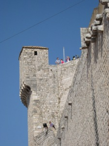Strollers atop Dubrovnik's walled city